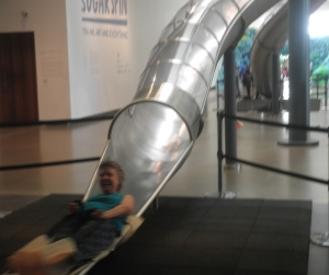 photo of me on a slippery slide at GOMA